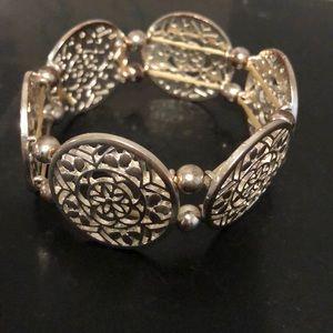Francesca's silver tone filigree disc bracelet.
